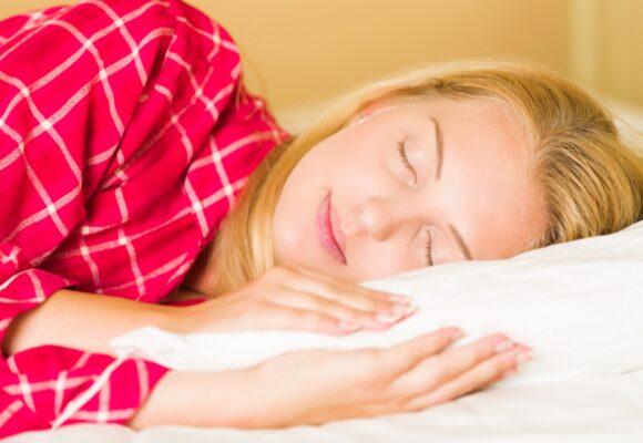 Sleeping woman enjoying sunlight
